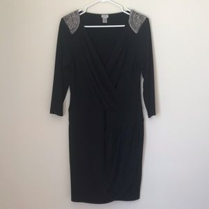 Black Caché cocktail dress with chain detail